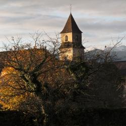 Soleil levant sur l'église Saint-Orens - Mirepeix · © stockli